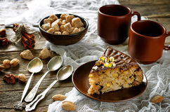 Cake with nuts, chocolate chips and chocolate glaze Royalty Free Stock Images