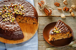 Cake with nuts, chocolate chips and chocolate glaze Stock Photo
