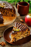 Cake with nuts, chocolate chips and chocolate glaze Stock Image