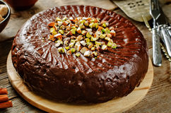 Cake with nuts, chocolate chips and chocolate glaze Royalty Free Stock Photography