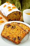 Cake with orange candied peel, chocolate drops and citrus drink Royalty Free Stock Photography
