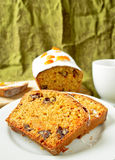 Cake with orange candied peel, chocolate drops and citrus drink Stock Images