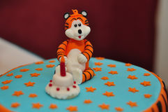 Cake. Orange cake for a child with a blue tiger Stock Images