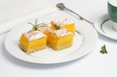 Cake with orange cream. Orange cake on white plate, dessert Stock Photos