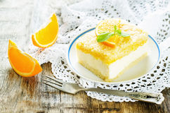 Cake with orange, cream cheese and crumbs. On a dark woody background. tinting. selective focus on mint stock photo