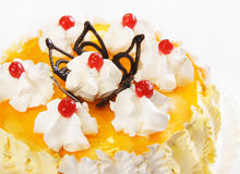 Cake with orange jelly and cherries Royalty Free Stock Photos