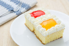 Cake, orange and strawberry flavored berries in white plate. Royalty Free Stock Images