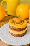 Cake. Orange Cake in white dish on the wood table Stock Image