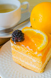 Cake. Orange Cake in white dish on the wood table Royalty Free Stock Photo