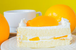 Cake. Orange Cake in white dish on the wood table Royalty Free Stock Photos