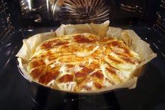 Cake in oven stock fotografie
