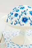 Cake with painted flowers. Dome shaped cake covered with fondant. The fondant has been painted with food colouring Stock Image