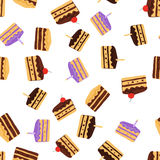 Cake pattern. Seamless background. Pattern of different pieces of cake with different fillings Stock Images