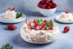 Cake Pavlova With Meringue, Strawberry And Cream Stock Photos