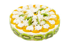 Cake with peaches, kiwi and whipped cream Stock Images