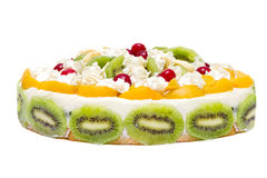 Cake with peaches, kiwi and whipped cream Stock Photo