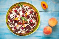 Cake with peaches and raspberries Stock Photo