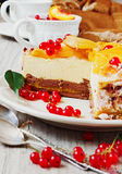 Cake with peaches and red currants Royalty Free Stock Photo
