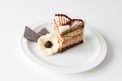 Cake piece. A piece of meringue layered cake with fork on a white plate royalty free stock images