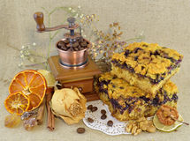 Cake pieces and coffee grinder Stock Images
