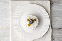 Cake with pistachio and blueberry on the white wooden table top view Stock Photography