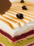 Cake pistachio, strawberries and cream Stock Images