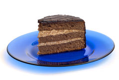 Cake on plate. Chocolate cake on blue plate Stock Image
