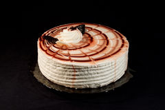 Cake on a plate. On a black background Royalty Free Stock Images