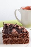 Cake on a plate and cup of tea Royalty Free Stock Image