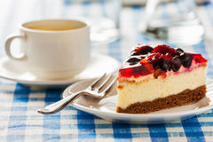 Cake on plate with fork and coffee cup Stock Photo