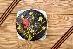Cake on a plate and St. George ribbons in honor of May 9 - the day of victory in the Great Patriotic War Stock Photos