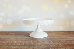Cake plate on vintage wooden table over bokeh background Royalty Free Stock Photography