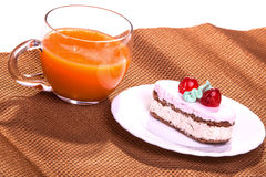 Cake on plates and juice cups isolate on white Royalty Free Stock Photos