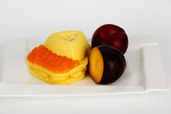 Cake and plums Royalty Free Stock Photo