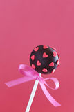 Cake Pop. Chocolate cake pop decorated with pink sugar hearts Royalty Free Stock Image