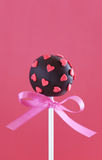 Cake Pop. Chocolate cake pop decorated with pink sugar hearts, selective focus Royalty Free Stock Images