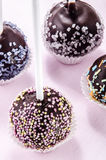 Cake pop with coloured sprinkles Royalty Free Stock Images