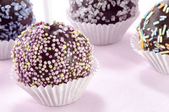 Cake pop with coloured sprinkles Royalty Free Stock Photos