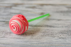 Cake pop with pink frosting. Royalty Free Stock Image