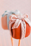 Cake pops as a gift. Two cakepops with a fondant bow for valentine and birthday celebrations Stock Photography
