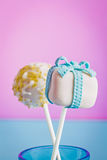 Cake pops as a gift with a candle. Cake pops as a gift, for celebration or maybe for valentine Stock Photos