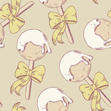Cake pops with bow seamless pattern Stock Images