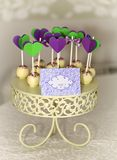 Cake-pops on carved roundel. Delicious sweet buffet with cake-pops on carved roundel Stock Photos