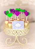 Cake-pops on carved roundel. Delicious sweet buffet with cake-pops on carved roundel Royalty Free Stock Images