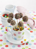 Cake pops. Chocolate cake pops candy on a stick with dragee Royalty Free Stock Image