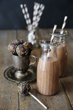 Cake pops and chocolate milk on table Royalty Free Stock Photo