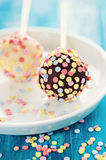 Cake pops. Colorful cake pops with candied confetti on blue background Stock Images