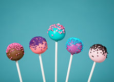 Cake Pops. Colorful cake pops with sprinkles over a teal blue background Stock Image