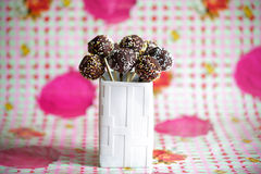 Cake pops covered with chocolate and colorful sprinkles Royalty Free Stock Photography