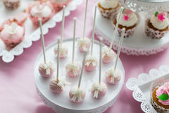 Cake pops and cupcakes stock photo